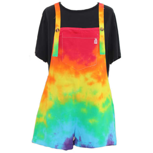 short dungarees in a rainbow colourway over a black t-shirt on a whtie background