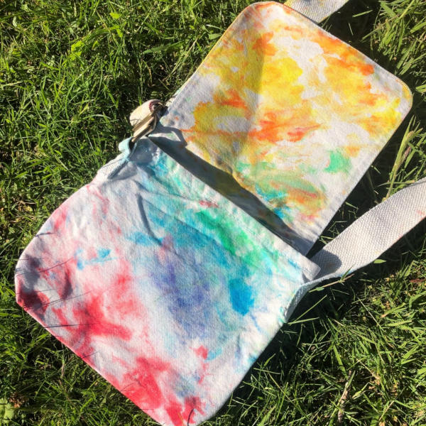 mini messenger bag in a marbled rainbow design